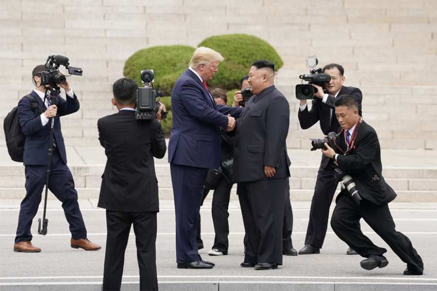 "U.S. President Donald Trump meets with North Korean leader Kim Jong Un June 30, 2019, in Panmunjom, South Korea, at the demilitarized zone separating the two Koreas. After praying the Angelus with pilgrims gathered in St. Peter's Square June 30, the Pope Francis called the historic meeting a ""good example of a culture of encounter."""