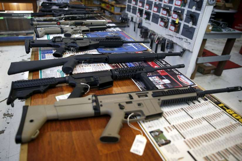 Guns for sale are displayed in Roseburg Gun Shop in Roseburg, Ore., Oct. 3.