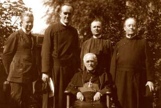 In 1913, Archbishop Neil McNeil (seated) invited Paulist Father Thomas Burke, second from the left, to Toronto to minister to the University of Toronto's 250 Catholic students. Burke set up U of T's Newman Centre. After a century in Toronto, running St. Peter's parish, the Paulists are returning to the United States due to declining vocations.