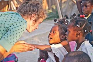 Morgan Wienberg now lives in Haiti full-time, working to give Haitian children the support for a good education and a good home.