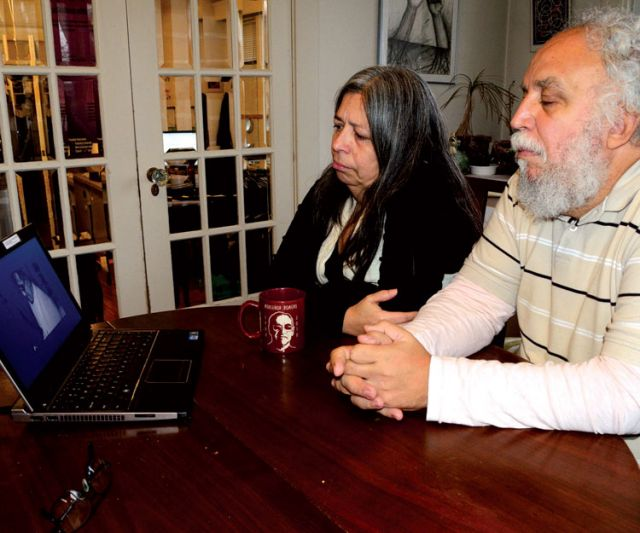 "Francisco Rico-Martinez and his wife Loly Rico relive the atrocities of El Salvador's civil war, which they lived through for more than a decade, while watching the music video for ""Romero."""