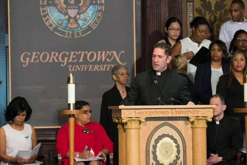 "Jesuit Father Timothy Kesicki, president of the Jesuit Conference of Canada and the United States, delivers the homily at an April 18 ""Liturgy of Remembrance, Contrition and Hope"" in Gaston Hall on the campus of Georgetown University in Washington."