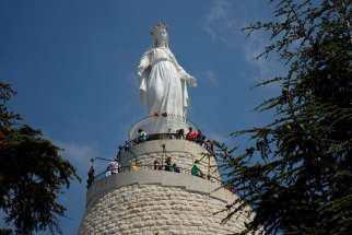 People visit the Shrine of Our Lady of Lebanon in 2012 in the village of Harissa near Beirut. Muslims and Christians alike come to the shrine.