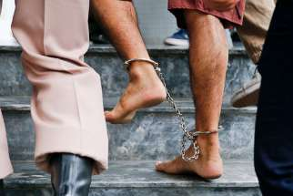 The shackled feet of a bombing suspect in Bangkok, Thailand, are seen as he is escorted by officers and prison personnel to Military Court Feb. 16. Pope Francis asks world leaders for a Jubilee Year moratorium on the death penalty.