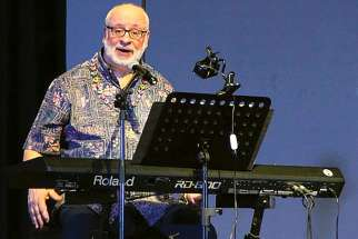 Catholic composer David Haas is shown in a concert at the Ateneo de Manila University in Quezon City, Philippines, in this 2016 photo.