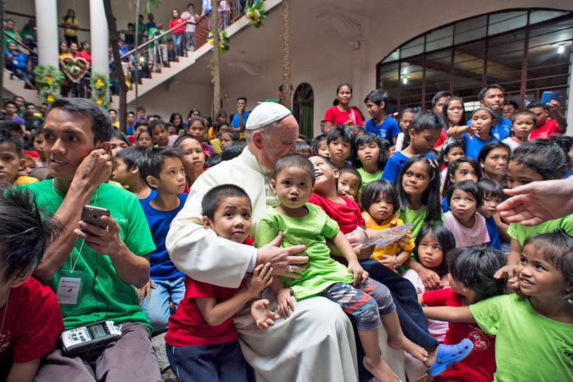 Pope Francis is pictured with youths at a home for former street children in Manila, Philippines, Jan. 16.