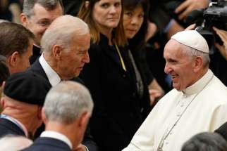 U.S. Vice President Joe Biden meets Pope Francis after both leaders spoke at a conference on adult stem cell research at the Vatican April 29.
