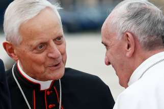 Cardinal Donald W. Wuerl of Washington talks with Pope Francis at Andrews Air Force Base in Maryland near Washington Sept. 22, 2015. Cardinal Wuerl announced Sept. 11 that he will meet soon with the pope to discuss the resignation he submitted three years ago when he turned 75.