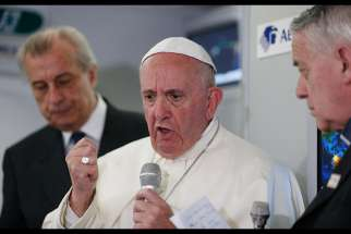 Pope Francis answers questions from journalists aboard his flight from Ciudad Juarez, Mexico, to Rome Feb. 17.