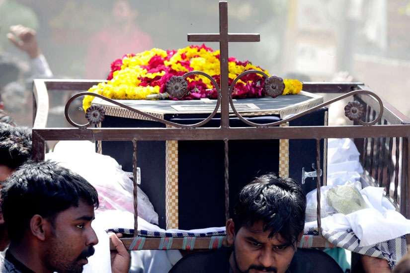 People carry the coffin of a suicide bomb victim in Lahore, Pakistan, March 28. A landmark declaration by the third global conference on the world's religion, which rejects fanaticism and terrorism, was adopted in Montreal Sept. 14.
