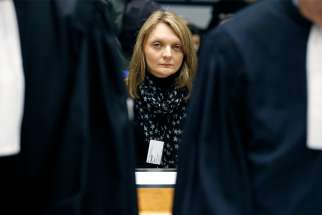 Rachel Lambert, the wife of Vincent Lambert, sits behind lawyers as she waits for the start of a hearing concerning the case of her husband at the European Court of Human Rights in Strasbourg, France, in this Jan. 7, 2015, file photo. Vincent Lambert, 42, a quadriplegic since an automobile accident in 2008, has been on a feeding tube at a hospital in Reims. The hospital has ordered his food and water be removed April 19.