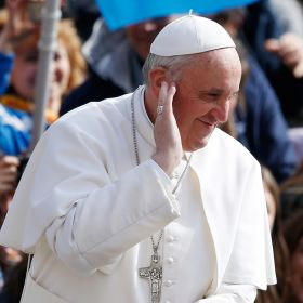 Pope Francis gestures as he arrives to lead his general audience in St. Peter's Square at the Vatican April 3.