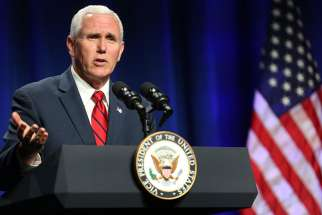 U.S. Vice President Mike Pence gestures as he speaks during the National Catholic Prayer Breakfast June 6 in Washington.