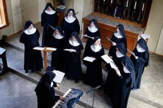 The Benedictines of Mary, Queen of Apostles rehearse songs in their new chapel in Gower, Mo., Feb. 17.