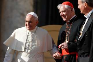 Pope Francis is pictured with Cardinal Gerhard Muller, prefect of the Congregation for the Doctrine of the Faith, during his general audience in St. Peter's Square at the Vatican Nov. 19.