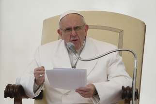 Pope Francis speaks during his general audience in St. Peter's Square at the Vatican Feb. 22.