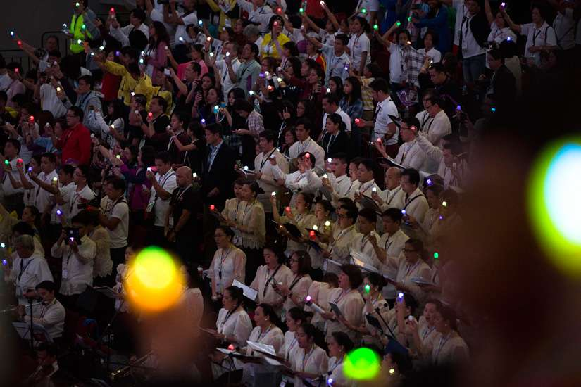 People hold electric candles during the closing ceremony of a meeting with families, led by Pope Francis at the Mall of Asia Arena in Pasay City, Philippines, Jan. 16.