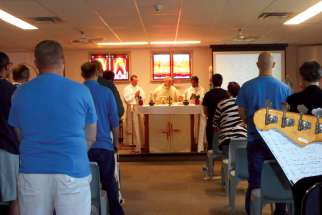Vancouver Archbishop J. Michael Miller celebrates Mass with inmates at a B.C. institution.