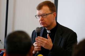 Jesuit Father Hans Zollner, a professor of psychology and president of the Centre for Child Protection at the Pontifical Gregorian University in Rome, leads a briefing for journalists in Rome Feb. 12, 2019. The briefing was to prepare for the Feb. 21-24 Vatican meeting on the protection of minors in the church. Father Zollner is on the organizing committee for the meeting.