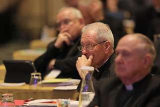 Bishops listen to a speaker Nov. 13 at the fall general assembly of the U.S. Conference of Catholic Bishops in Baltimore.