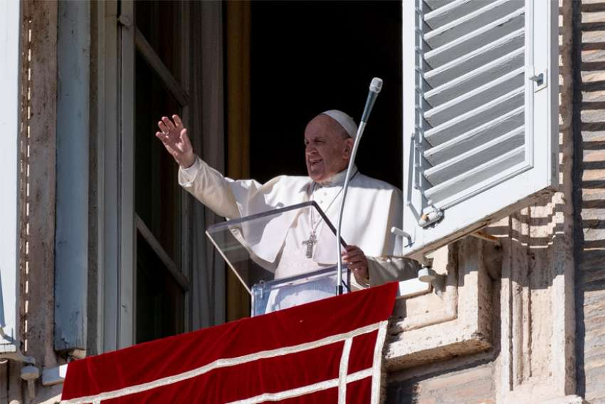 Pope Francis leads the Angelus from the window of his studio overlooking St. Peter's Square at the Vatican Dec. 29, 2019.