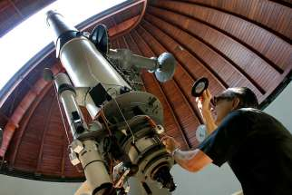 The Rev. Emmanuel Carreira operates the telescope at the Vatican Observatory in Castel Gandolfo, south of Rome, on June 23, 2005. The Vatican Observatory, one of the world's oldest astronomical institutes, selects young, promising scholars for courses at the papal summer palace.