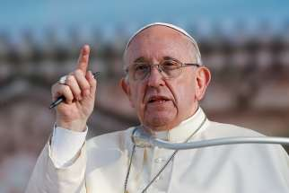 Pope Francis gestures as he leads a meeting with young people in Palermo, Sicily, Sept. 15.
