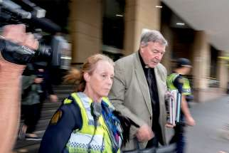 Australian Cardinal George Pell departs the Melbourne Magistrates' Court March 27 in Melbourne. Cardinal Pell appeared in court for the magistrate to hear evidence and decide whether there is a strong enough case to go to trial on sexual abuse charges, which the cardinal has denied.
