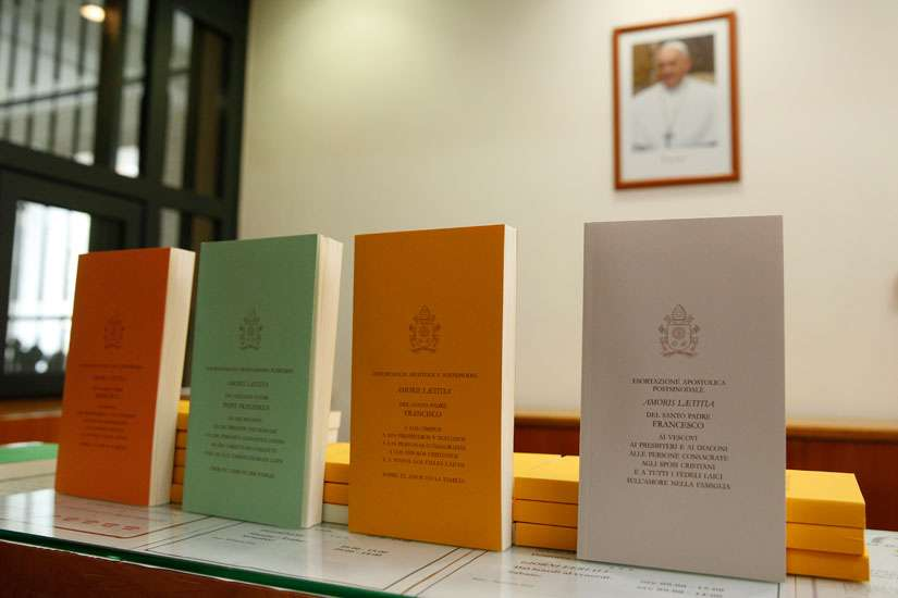 "Copies of Pope Francis' apostolic exhortation on the family, ""Amoris Laetitia"" (""The Joy of Love""), are seen during the document's release at the Vatican April 8. The exhortation is the concluding document of the 2014 and 2015 synods of bishops on the family."