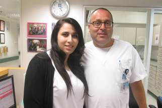 Rula Badarna, left, and Stuart Levy, both nurses at Hadassah Medical Center in Jerusalem, say their ward is a model of religious coexistence and friendship.