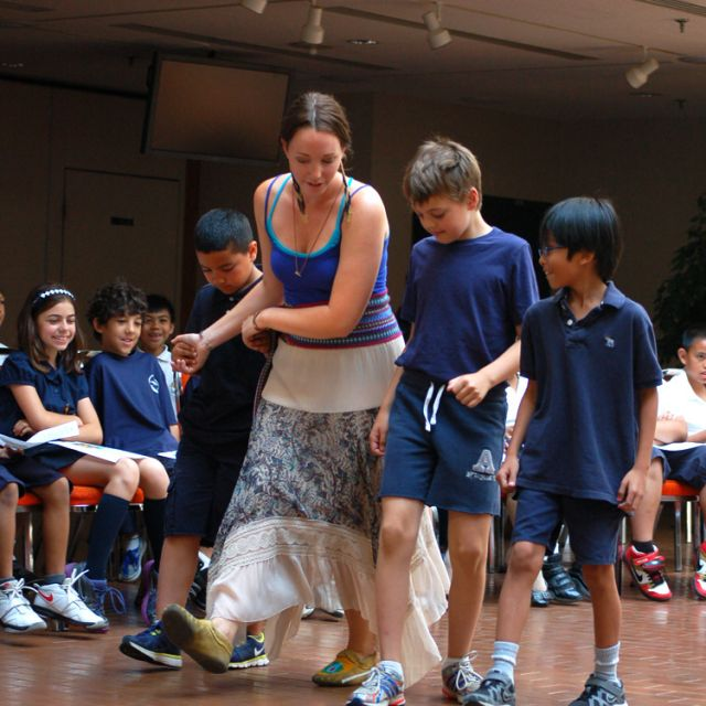 Three young boys from Our Lady of Fatima Catholic School eagerly take the opportunity to jig with Ginny Gonneau, a Métis descendant from Barrie.