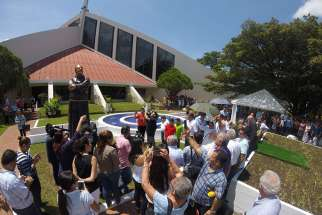 Well-wishers gather July 9 at the dedication of a statue honoring Franciscan Father Flavian Mucci in Sonsonate, El Salvador. The statue marks the arrival of Father Mucci to El Salvador, where the founder of the Agape Association of El Salvador has served the poor for 50 years.