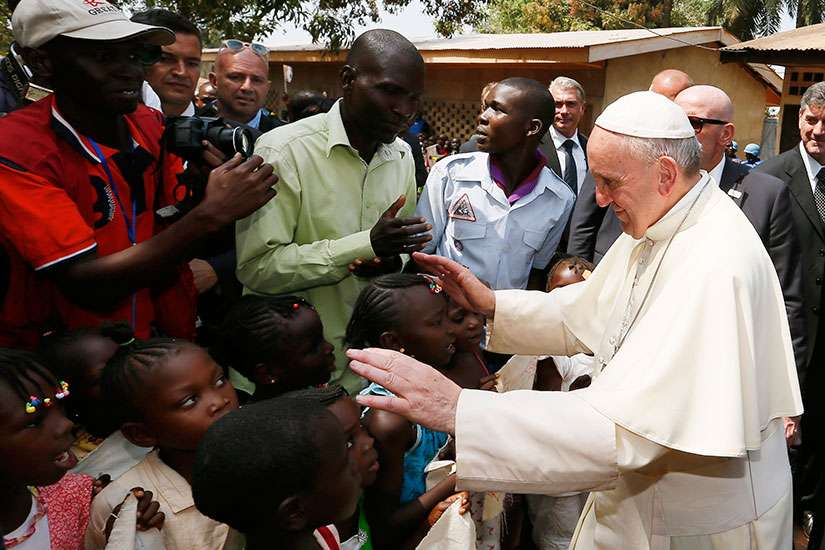 Pope Francis greets children as he visits a refugee camp in Bangui, Central African Republic, Nov. 29.