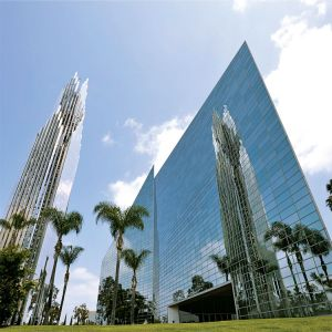 Palm trees surround the former Crystal Cathedral in Garden Grove, Calif., which was purchased for $57.5 million by the Catholic diocese of Orange, Calif., in February. The diocese announced June 9 it has renamed the structure Christ Cathedral.