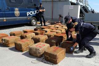 Spanish national police officers unload bales of seized drugs in Las Palmas, on the Canary island of Gran Canaria, Spain, Oct. 23. Pope Francis said illegal drug makers and dealers are traffickers of death and must be stopped.