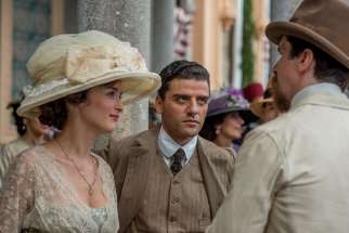 "Charlotte Le Bon, Oscar Isaac and Christian Bale star in a scene from the movie ""The Promise."" The film dramatizes the genocide of Armenians in the Turkish-ruled Ottoman Empire at the outset of World War I."