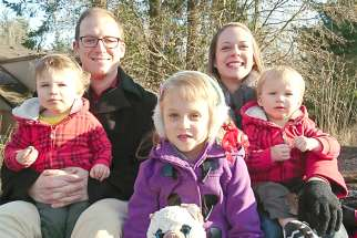 Katherine Babcock with husband Tyson and their three children.