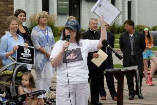 "Carol Remer of Battle Creek, Iowa, leads a chant during a ""Women Betrayed"" rally in Sioux City July 28. Demonstrations were held in 65 cities across the country calling for an end to federal funding of Planned Parenthood."