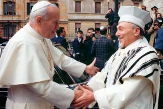 St. John Paul II greets Rabbi Elio Toaff in 1986 at Romeís main synagogue. Rabbi Toaff, who served as Rome's chief rabbi from 1951 to 2000, died April 19 at age 99.