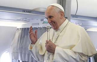 Pope Francis speaks to media on his flight to speak at European Parliament in France