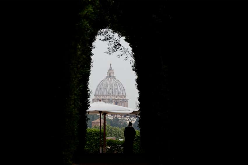 The dome of St. Peter's Basilica at the Vatican is seen from the Aventine Hill in Rome in this May 2, 2018, file photo. Pope Francis has approved pay cuts for cardinals, top managers and religious personnel working at the Vatican.