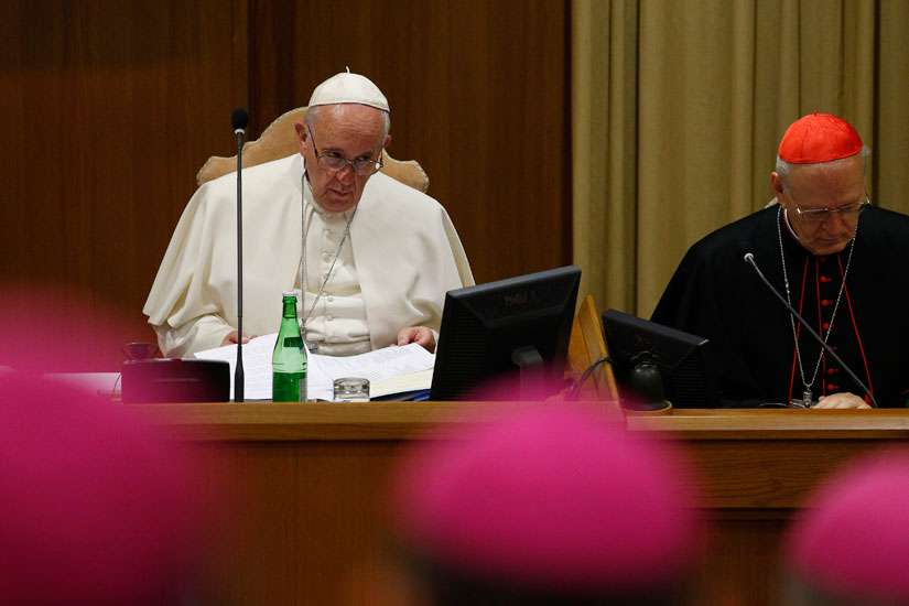 Pope Francis participates in prayer at the start of a session of the Synod of Bishops on the family at the Vatican Oct. 23.