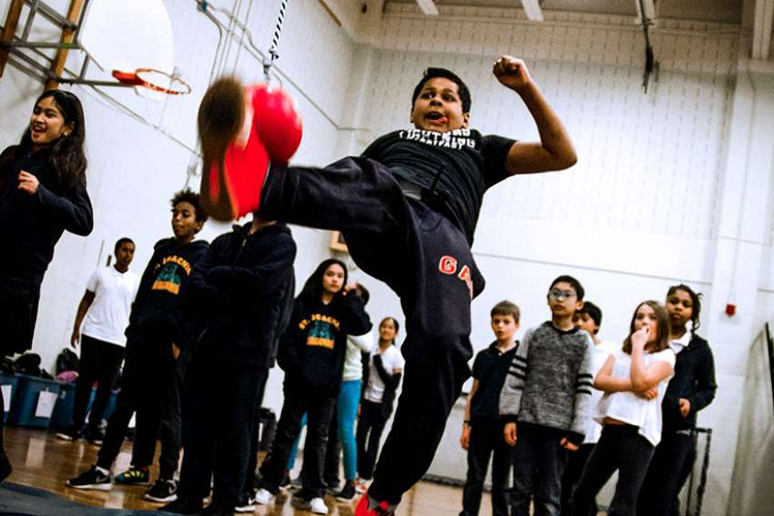 Jortany Martienz, a Grade 5 student from St. Joseph Catholic School in the Leslieville neighbourhood, participates in an event at his school's Northern Spirit Games Feb. 27.
