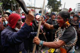 Indigenous people take part in a protest against Ecuadorian President Lenin Moreno's austerity measures in Quito, Ecuador, Oct.11, 2019. Ecuadorian observers at the Synod of Bishops for the Amazon at the Vatican are keeping an eye on massive protests that have claimed the lives of at least five people in their country.
