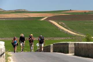 Pilgrims hiking from southern France to Santiago de Compostela, Spain.