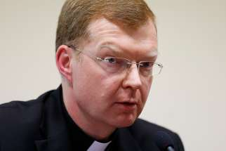 Jesuit Father Hans Zollner, a professor of psychology and president of the Center for Child Protection at the Pontifical Gregorian University in Rome, is pictured in a 2015 photo. Father Zollner has been on the frontlines of advocating for survivors of clerical sexual abuse and developing detailed programs to prevent abuse. He said the crisis unfolding again in the United States is a summons to a new way of envisioning the church and taking responsibility for it.