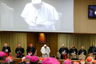 Pope Francis leads prayer in the synod hall at the Synod of Bishops on the Family.