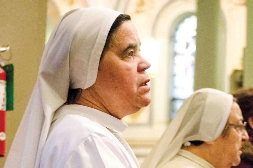 During a Jan. 31 Mass recognizing the World Day of Prayer for Consecrated Life, Sr. Zilda Carvalho says a prayer for the many youth she spoke to about religious life during the Year of Consecrated Life