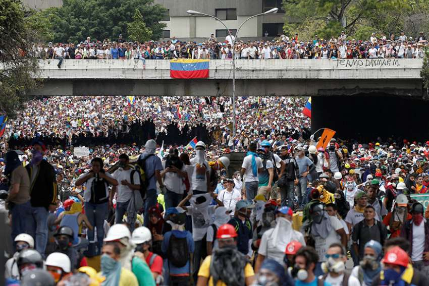 Demonstrators rally against Venezuelan President Nicolas Maduro in Caracas, Venezuela, May 3. Two days later, Pope Francis urged the country's bishops to remain close to the poor and needy.