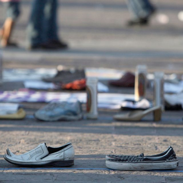 Shoes of missing people form the number 49, in memory of the mutilated victims dumped in Cadereyta, Mexico, are seen at the Macroplaza in Monterrey May 13. Suspected drug-gang killers dumped 49 headless bodies on a highway near Mexico's northern city of Monterrey in one of the country's worst atrocities in recent years.
